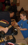 Mario explains the fine points of kendo to a young admirer.
